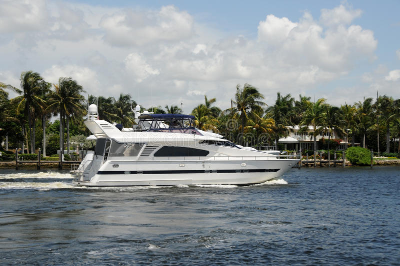 Luxury yacht on a Florida waterway. Luxury yacht cruises down the waterways of Fort Lauderdale, Florida stock photography