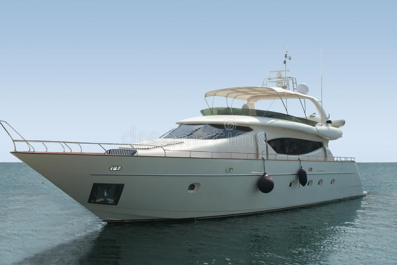 Luxury yacht with horizon line stock images