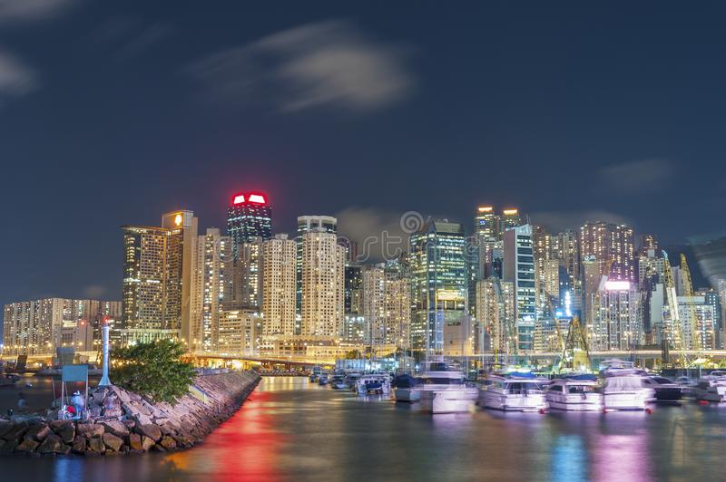 Luxury yacht in port in Hong Kong Harbor at night. Pier in Hong Kong Harbor at night stock photos