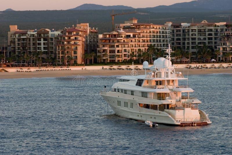 Luxury yacht at sunrise royalty free stock photo