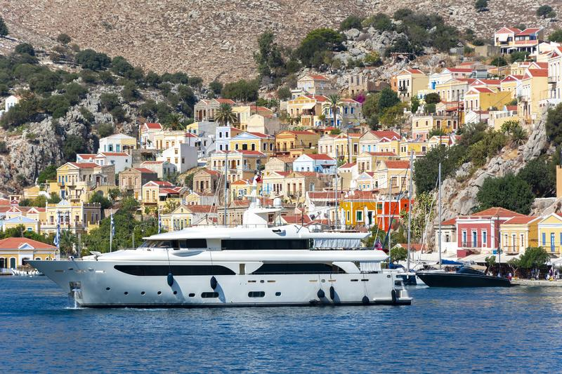 Luxury yacht in Symi port, Dodecanese islands, Greece royalty free stock photo