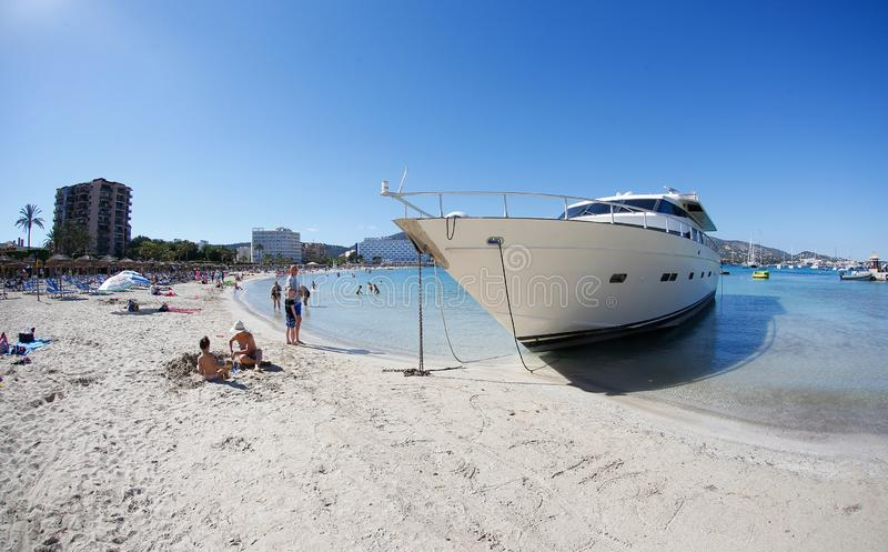 Yacht wrecked on Son Matias beach in Palmanova Mallorca. A luxury yacht wrecked in the sand of the Son Matias beach in Palmanova since last march 2019, when royalty free stock photo
