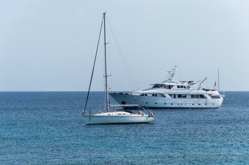 Luxury yachts in Mandraki harbor, Rhodes, Greece stock images