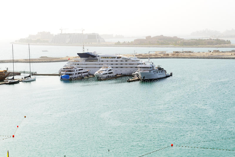 Luxury yachts near beach with a view on Jumeirah Palm