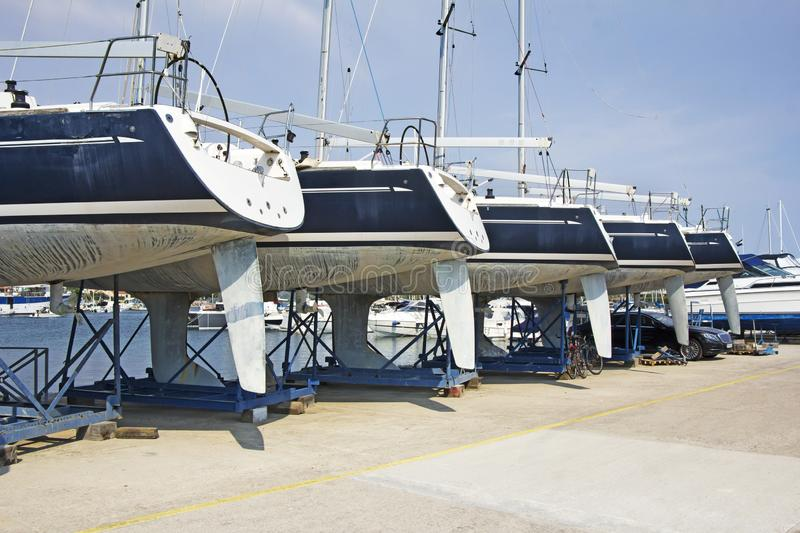 Luxury yachts at shipyard waiting for maintenance. And repair royalty free stock images