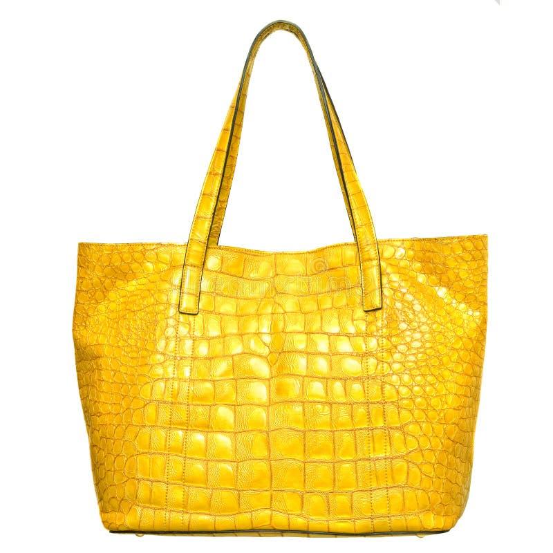 Luxury yellow leather female bag isolated on white. Background stock image