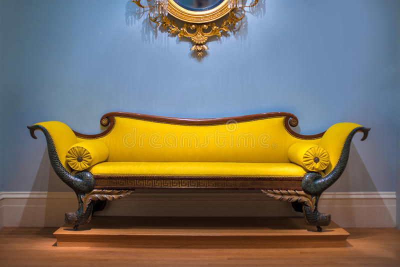 Luxury Yellow Sofa In Front Of The Blue Wall Stock Photo - Image of ...