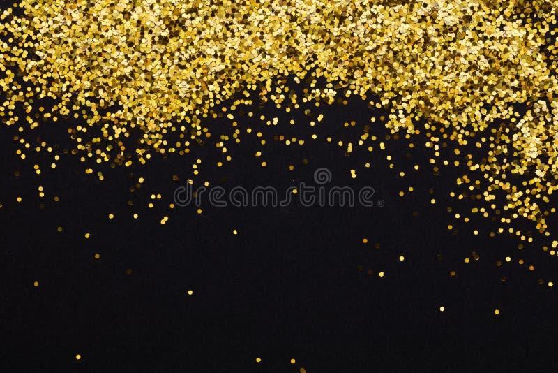 Luxusgoldfunkeln-Scheinrahmen auf blac stockfoto