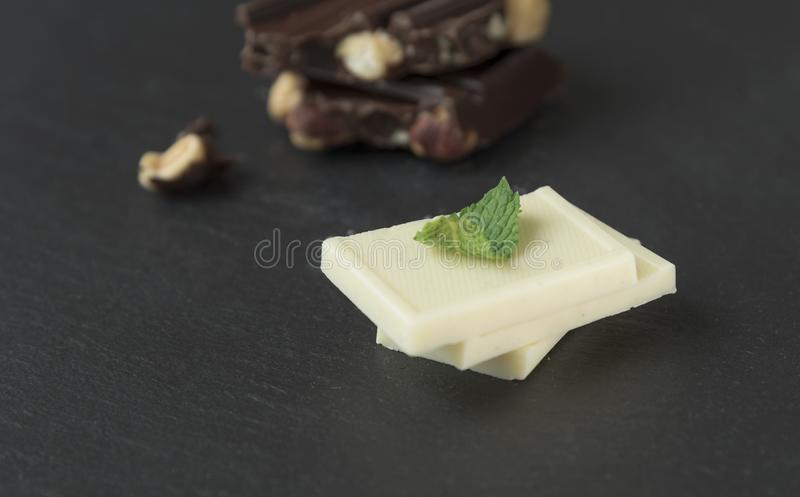 Luxuy white vanilla chocolate on grey slate royalty free stock photography