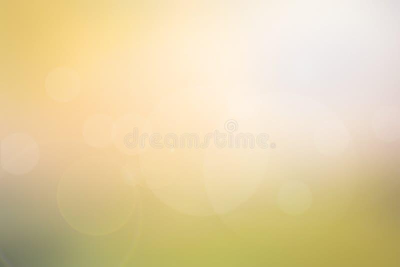 Luz abstracta - amarillo - ponga verde el fondo borroso fotos de archivo