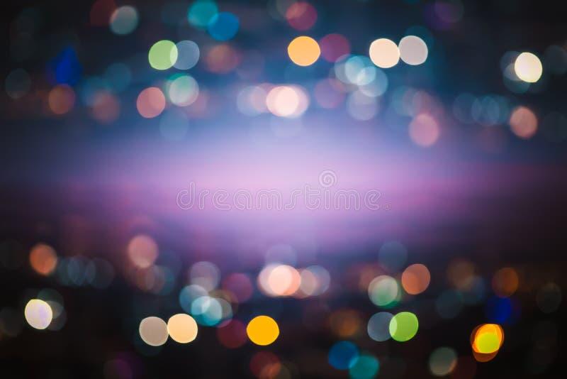Luz abstrata Bokeh da noite, fundo borrado fotografia de stock royalty free