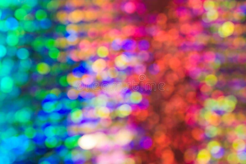 Luz abstrata do bokeh da cor do vestido da lantejoula do borrão foto de stock royalty free