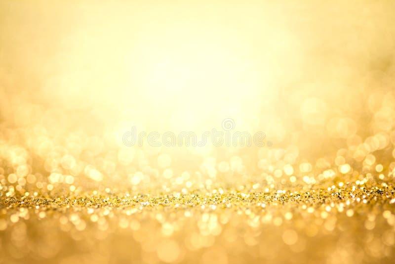 Luz abstrata do ouro para o fundo dos feriados imagens de stock royalty free