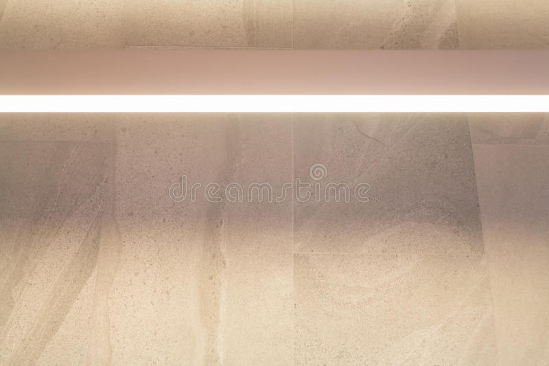 Luz caliente en la pared de mármol imagen de archivo