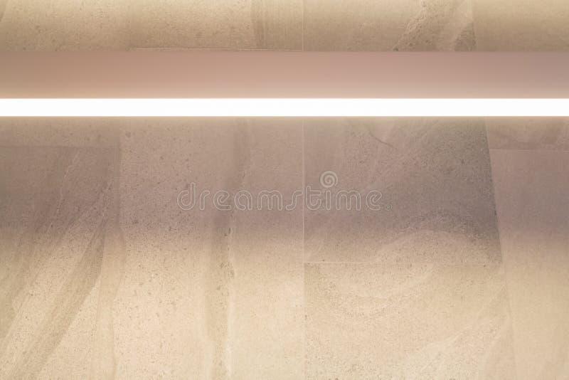 Luz caliente en la pared de mármol imagen de archivo libre de regalías