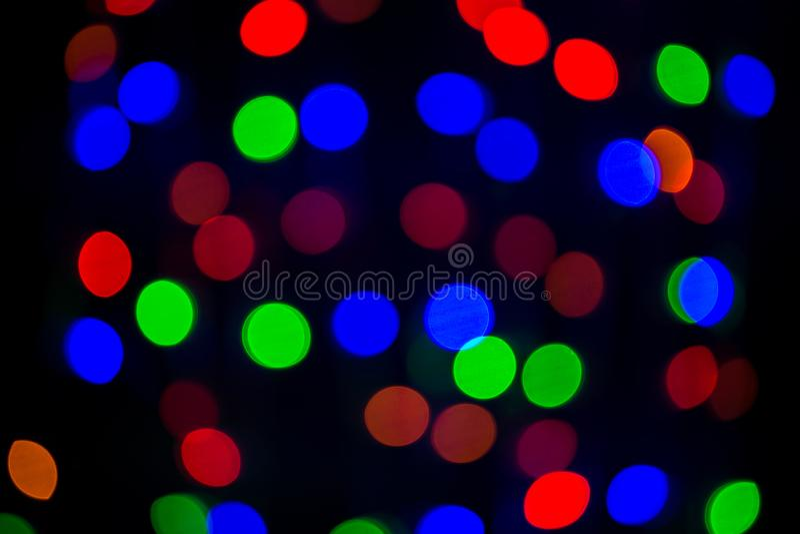 Luz colorida del bokeh en fondo negro luz viva del partido de la noche imagen de archivo libre de regalías