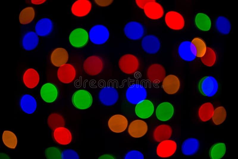 Luz colorida del bokeh en fondo negro luz viva del partido de la noche imágenes de archivo libres de regalías