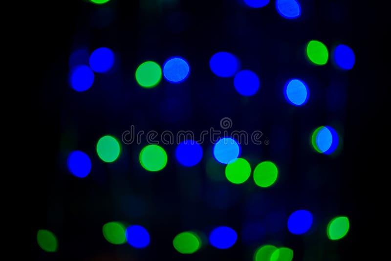 Luz colorida del bokeh en fondo negro luz viva del partido de la noche fotos de archivo