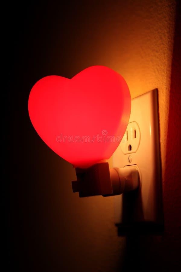 Luz da noite do coração imagens de stock
