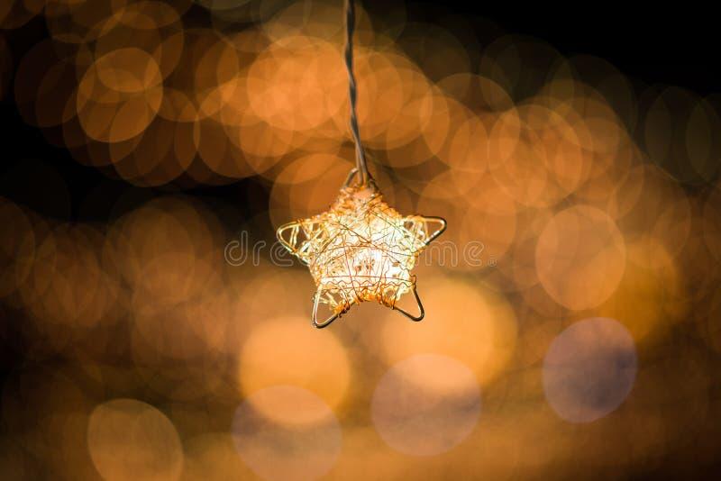 Luz de la estrella y fondo de Bokeh imagenes de archivo