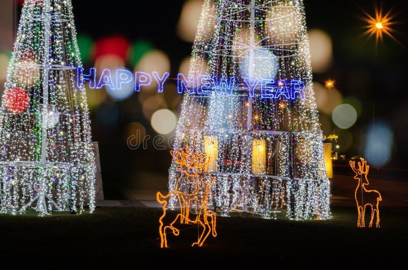 Luz de la Feliz Año Nuevo con el bokeh imagen de archivo libre de regalías