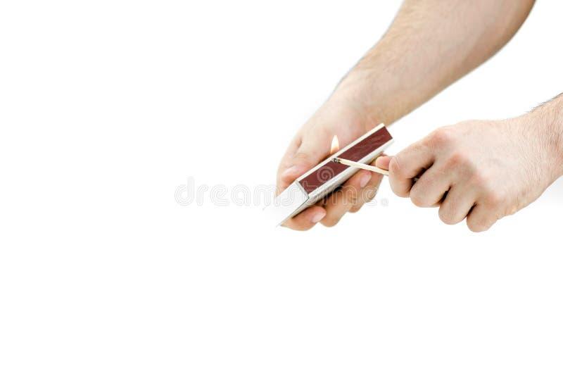 Luz de la mano un partido fotografía de archivo libre de regalías