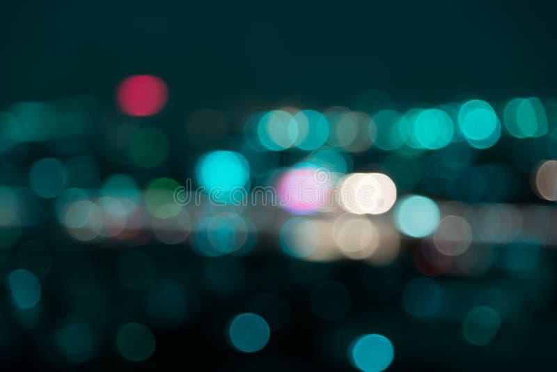 Luz de la noche de la ciudad del bokeh de la falta de definición foto de archivo libre de regalías