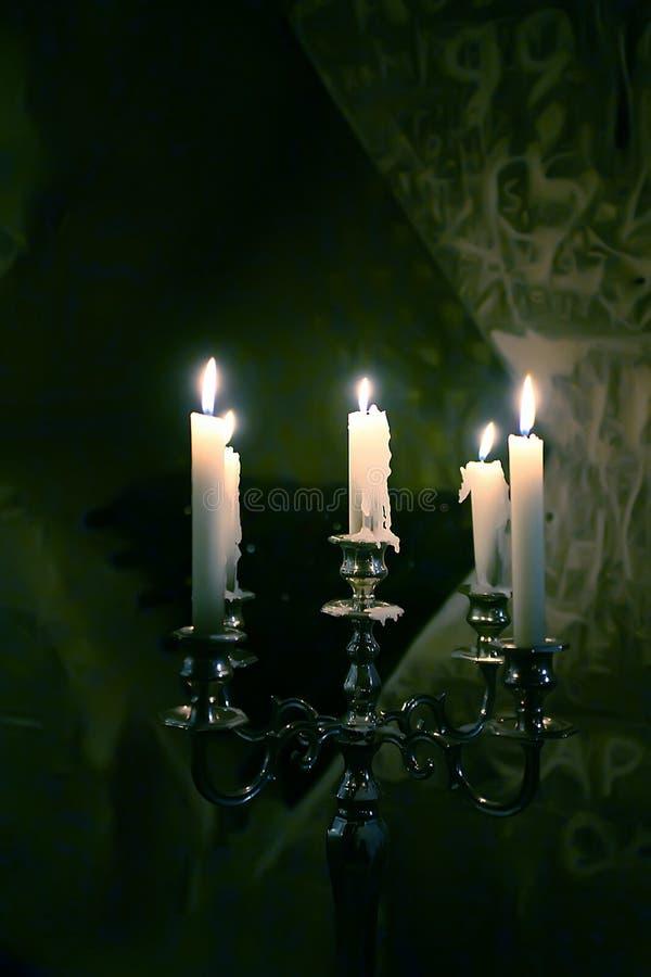 Luz de vela de prata fotografia de stock royalty free