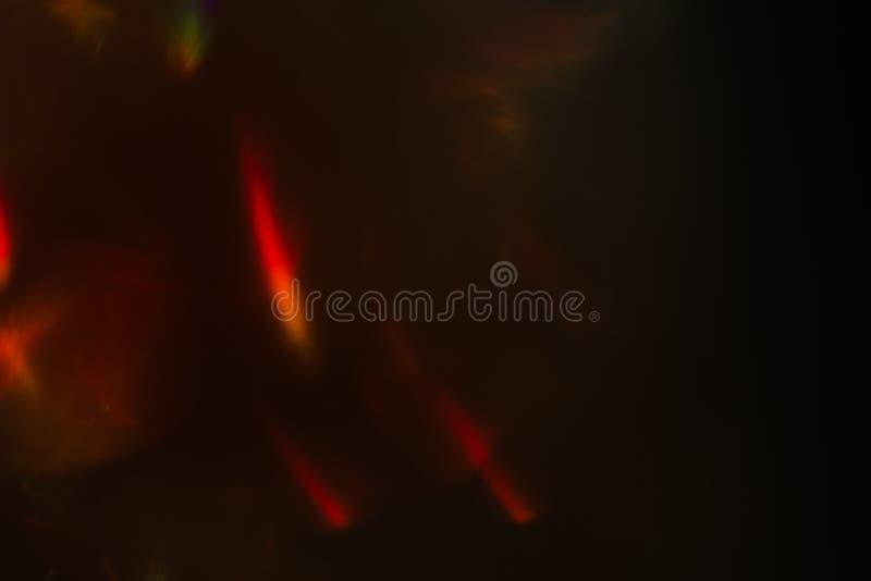 Luz defocused vermelha do fundo abstrato do alargamento da lente fotografia de stock royalty free