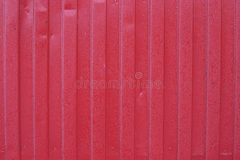 Luz del día natural del fondo rojo de la cerca imagenes de archivo
