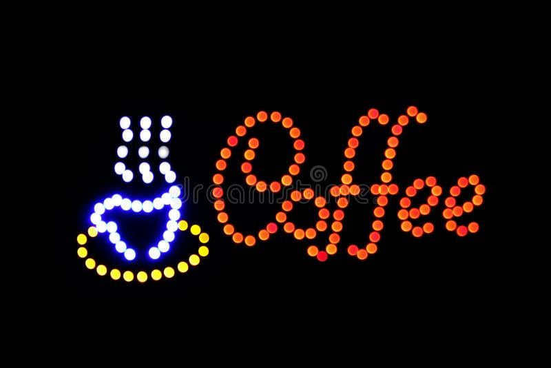 Luz do diodo emissor de luz Bokeh do sinal da cafetaria no fundo escuro, ponto colorido, néon do bokeh do signage da luz do sinal foto de stock