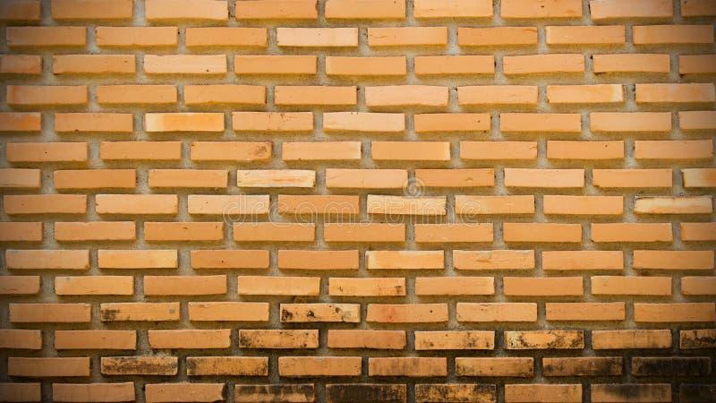 Luz do Grunge - parede marrom do sumário do tijolo imagens de stock royalty free