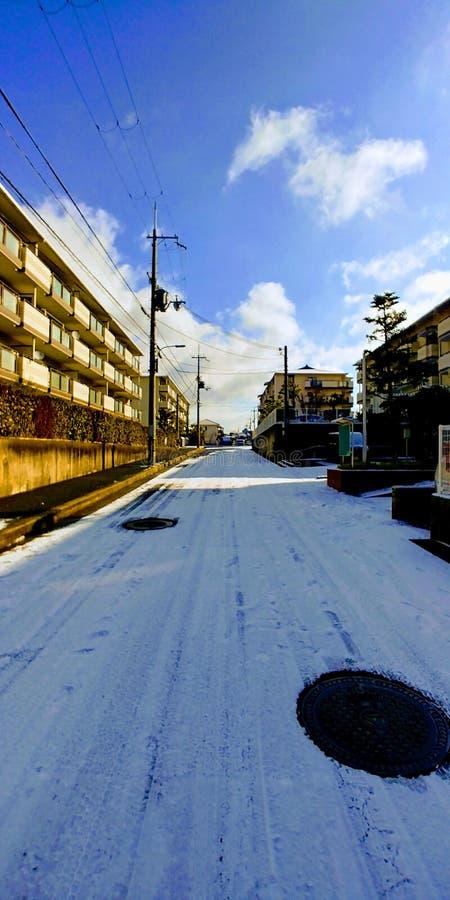 Luz do sol da neve em Osaka imagem de stock