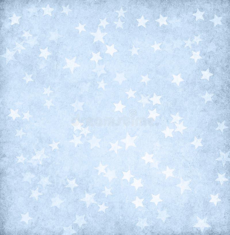 Luz do vintage - papel azul decorado com estrelas fotografia de stock royalty free