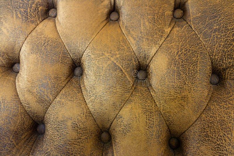 Luz do vintage - textura marrom do sofá, fundo de couro marrom do sofá do teste padrão fotografia de stock royalty free