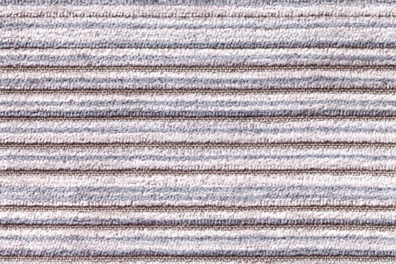 Luz - fundo cinzento de um material de matéria têxtil feito malha Tela com um close up listrado da textura fotos de stock