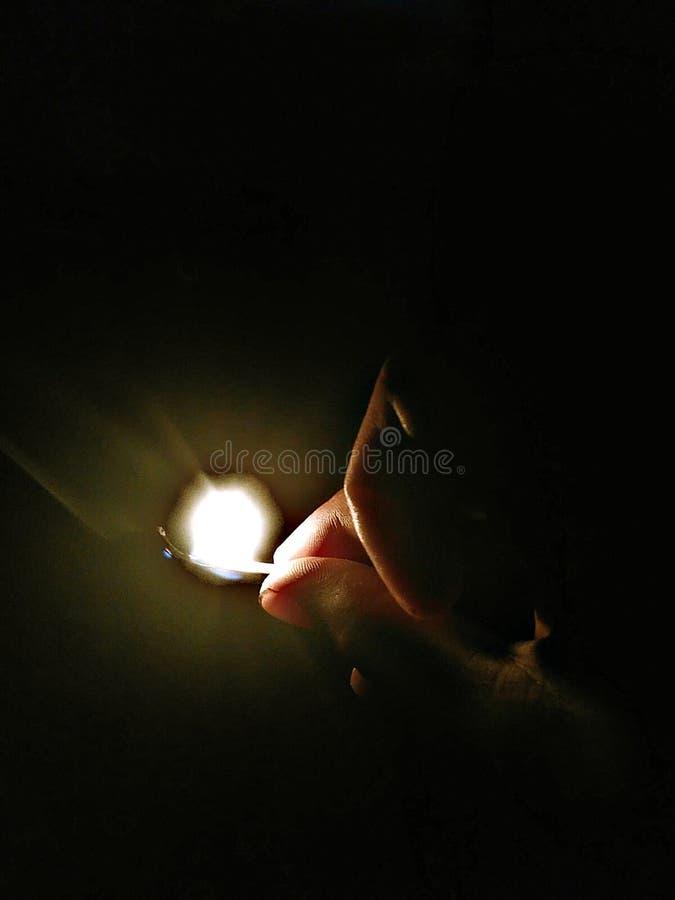 Luz na obscuridade fotografia de stock royalty free