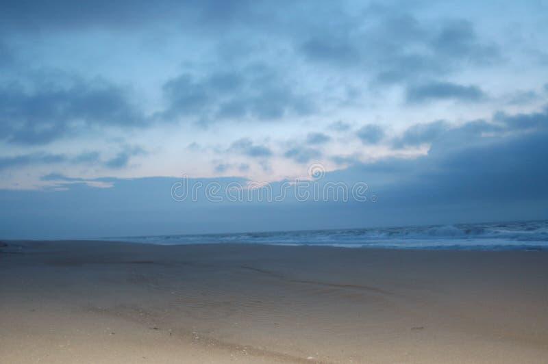 Luz solar na praia imagens de stock