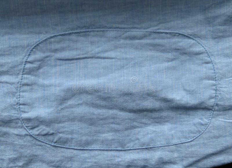 Luz - textura azul da tela com fundo do remendo imagem de stock