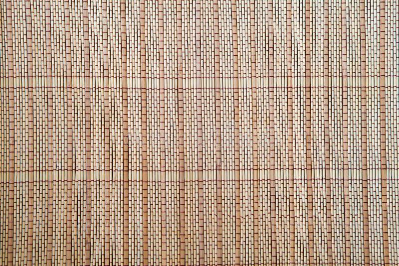 Luz - textura de bambu marrom do fundo da toalha de mesa da esteira fotos de stock royalty free