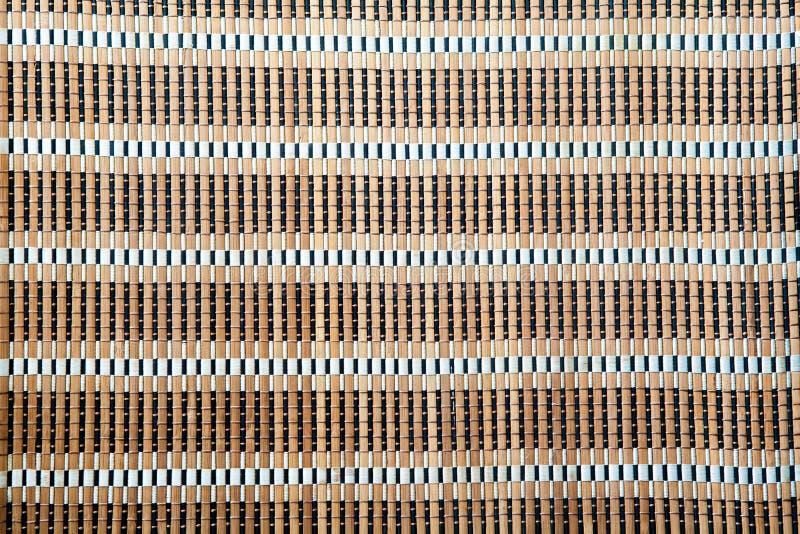 Luz - textura de bambu marrom do fundo da toalha de mesa da esteira imagem de stock royalty free