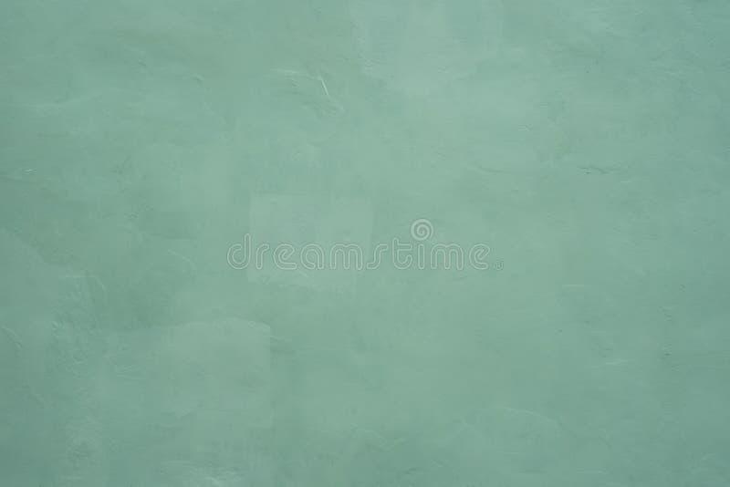 Luz - textura e fundo rachados verdes do muro de cimento para o int fotos de stock royalty free