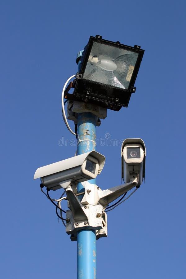 Luz y cámaras de la seguridad foto de archivo libre de regalías