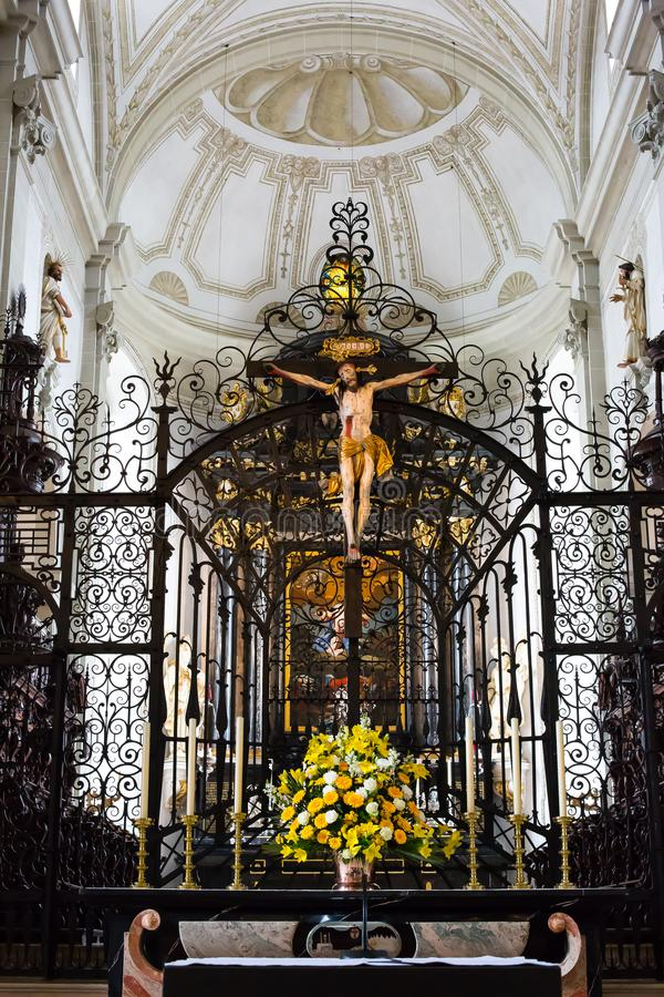 Jesus Crucified and altar at Hofkirche St. Leodegar - Luzern, Switzerland royalty free stock image