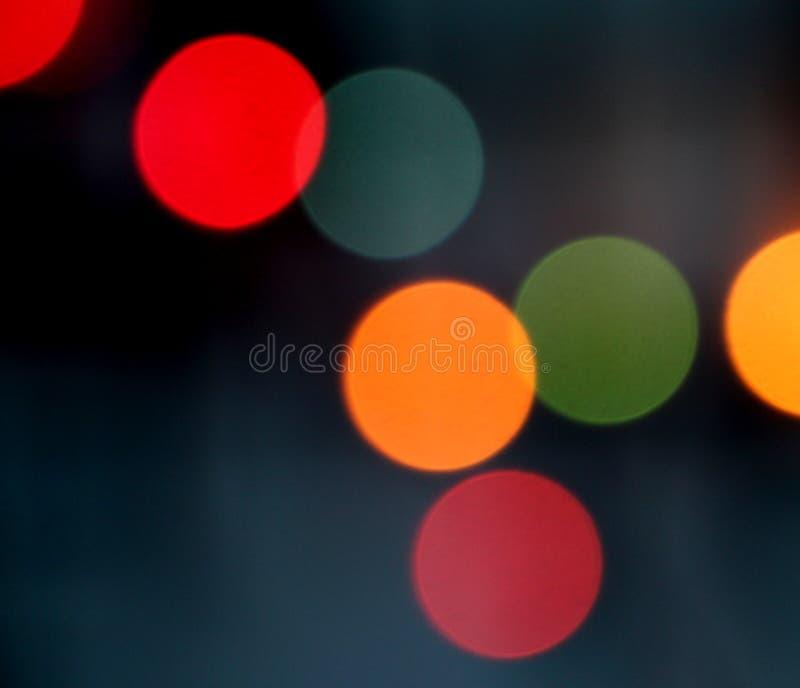 Luzes coloridas borradas do bokeh do fundo foto de stock