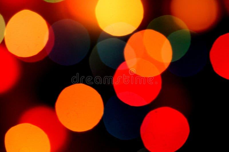 Luzes coloridas borradas do bokeh do fundo imagens de stock royalty free