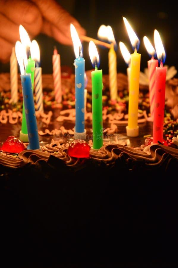 Luzes da vela do aniversário fotografia de stock royalty free
