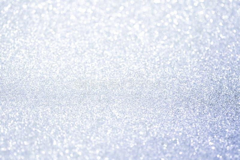 Luzes de prata abstratas do bokeh do brilho com fundo da luz suave imagens de stock royalty free