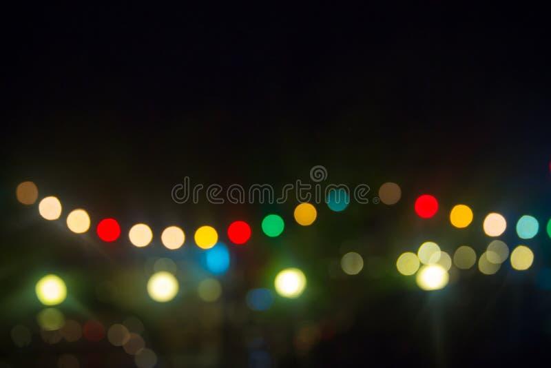 Luzes Defocused do bokeh, luz do bokeh do borrão, fundo do bokeh ponto claro colorido no fundo preto Imagem para o fundo fotos de stock royalty free