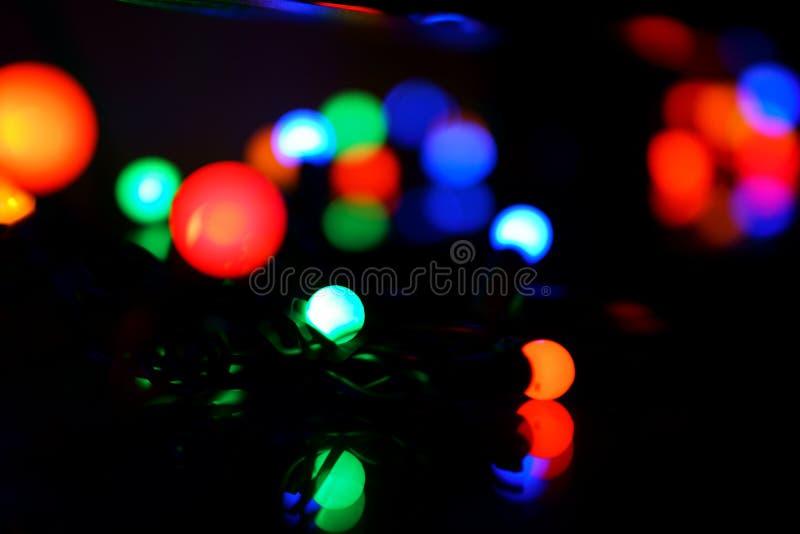 Luzes do feriado com fundo do bokeh foto de stock